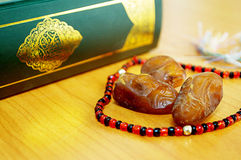 Date palm with quran. For greeting ramadan kareem stock photos