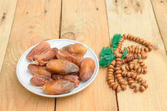 Date palm on the wood. Royalty Free Stock Photo