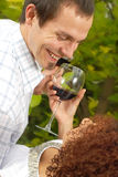 Date at the park. Two young lovers having some wine and sharing laughs at the park Stock Photos