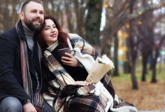 Date in a park lovers on a bench Stock Photo