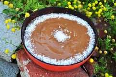 Date Pudding in a coconut bowl stock images