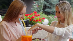 Date in a quiet cafe terrace. The girl friend shows an engagement ring stock footage