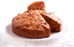 Date and raisin cake on plate Royalty Free Stock Images