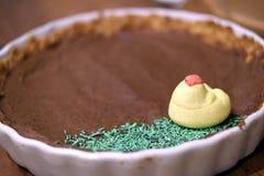Date tart with sugar chicken decoration Stock Image