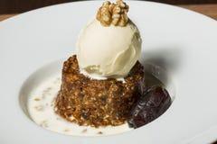 Date and walnut dessert with vanilla ice cream Stock Images