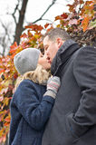 Date. Young woman and man kisses outdoor Royalty Free Stock Photo