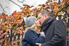 Date. Young woman and man kisses outdoor. Autumn Stock Photo