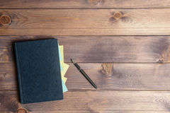 Datebook. The datebook with black pen are on the table Royalty Free Stock Image