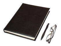 Datebook, pen and glasses. Isolated on white Royalty Free Stock Images