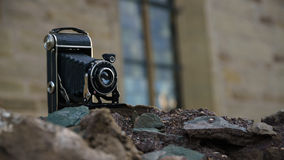 Dated Camera. On a prehistoric Wall Royalty Free Stock Photos