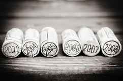 Dated wine bottle corks on the wooden background stock photography