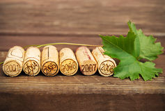 Dated wine bottle corks on the wooden background Stock Photo