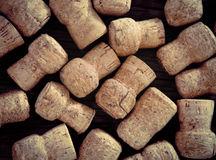 Dated wine bottle corks on the wooden background Royalty Free Stock Photography
