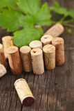 Dated wine bottle corks on the wooden background Royalty Free Stock Photo