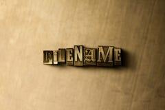 DATEINAME - Nahaufnahme des grungy Weinlese gesetzten Wortes auf Metallhintergrund Lizenzfreie Stockfotos