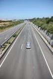 Datenbahn mit einigen Autos stockbilder