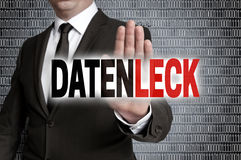Datenleck (in german data leak) with matrix is shown by business stock photo