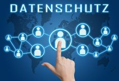 Datenschutz text concept. Datenschutz - german word for protection of data privancy - text concept with hand pressing social icons on blue world map background Stock Image