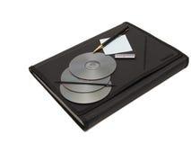 Datenträger- und Dokumentenfall auf Weiß Lizenzfreie Stockfotografie