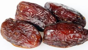 Dates. A group of four dates against a white background stock photos