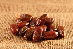 Dates. A pile of fresh dates on hessian Stock Photos