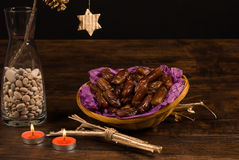 Dates. A basket of dried dates surrounded by Christmas decoration Royalty Free Stock Photo