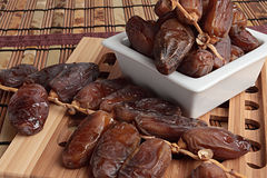 Dates. On a white plate Royalty Free Stock Image