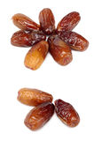 Dates. Some ripe appetizing dates on a white background Stock Photography