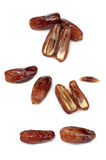 Dates. Some ripe appetizing dates on a white background Royalty Free Stock Photography