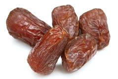 Dates. Five dry dates isolated on white background Royalty Free Stock Photo