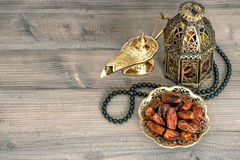 Dates, arabian lantern and rosary. Eid Mubarak Stock Photos