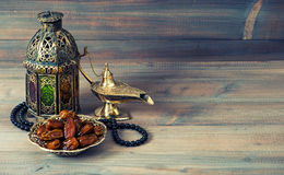 Dates, arabian lantern and rosary. Islamic holiday royalty free stock photo