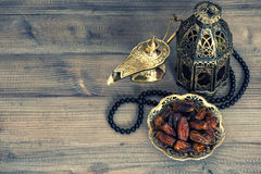 Dates, arabian lantern and rosary. Islamic holidays concept stock image