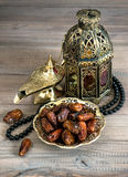 Dates, arabic lamps and rosary. Islamic holidays concept Royalty Free Stock Photos