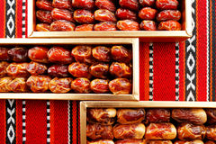 Dates arranged on Arabian woven fabric Royalty Free Stock Photography