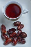 Dates and black tea Royalty Free Stock Image