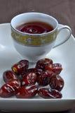 Dates and black tea Royalty Free Stock Photos