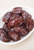 Dates in a bowl stock photos
