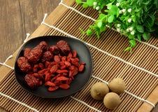 Dates chinoises et longan wolfberry et rouges Images libres de droits