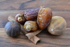 Dates, cinnamon and nutmeg Stock Photos