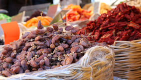 Dates and dried tomatoes for sale at the fruit market of souther. Baskets of dates and dried tomatoes for sale at the fruit market of southern Italy Stock Photography
