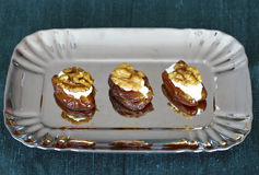 Dates filled with ricotta cheese and walnuts.  Stock Images