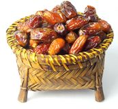 Dates Fruit. In a bamboo basket on white back ground Royalty Free Stock Photos