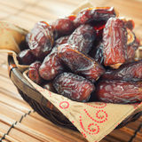 Dates fruit in basket. Royalty Free Stock Images