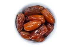Dates fruit date from above bowl  on white Stock Photography