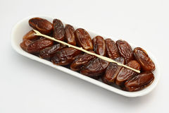 Dates fruit. Fresh dates fruit align in container with toothpick Stock Photography