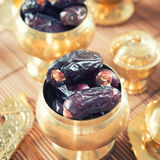 Dates fruit or kurma in metal bowl. Royalty Free Stock Photo