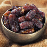 Dates fruit in metal bowl. Royalty Free Stock Image