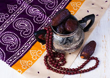 Dates fruit and rosary Stock Photo