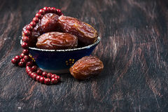 Dates fruit and rosary still life Royalty Free Stock Photo